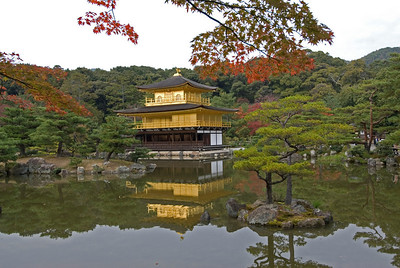 A profile of the Golden Pavilion reflected on water in Kyoto, Japan
