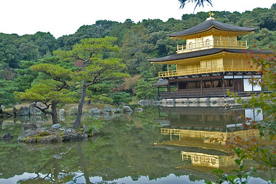 Golden Pavilion profile surrounded by pond in Kyoto, Japan