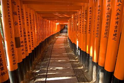 Japanese writings on posts at Fushimi Inari-taisha shrine path