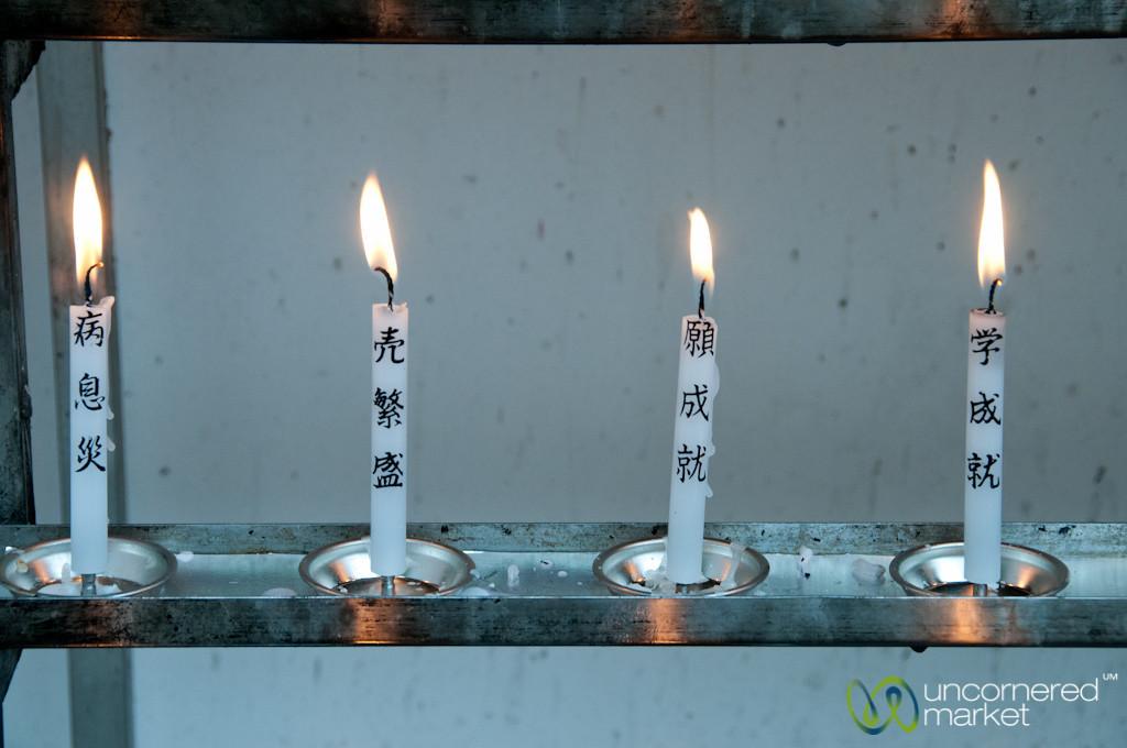 Lit Candles at Kinkaku-ji Temple - Kyoto, Japan