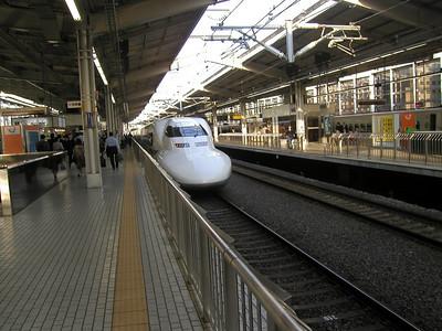 The Nozomi, Tokaido Shinkansen (JR700 bullet train ), 2hr 35min Tokyo-Osaka  , here at JR station Kyoto, May. A wonderful ride at upto 300kph! 2004