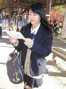 Kyoto the Kiyomizudera Temple, Japan Student with questionnaire for English language visitors 2004