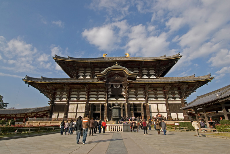 Tourists on the entrance of Todaiji Temple in Nara, Japan
