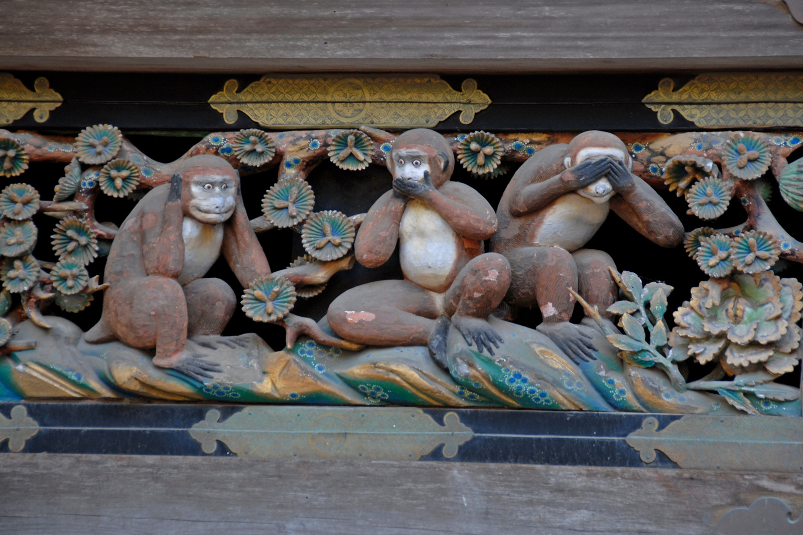 Three wise monkeys statue at a temple in Nikko, Japan