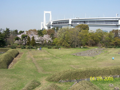 """Dai-Roku Daiba or """"No. 6 Battery"""", one of the original Edo-era battery islands, with the Rainbow Bridge in background walking distance from the developed area of Odaiba. 2005"""
