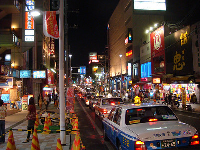 Taxis parked along the street in Kokusai Street in Okinawa, Japan
