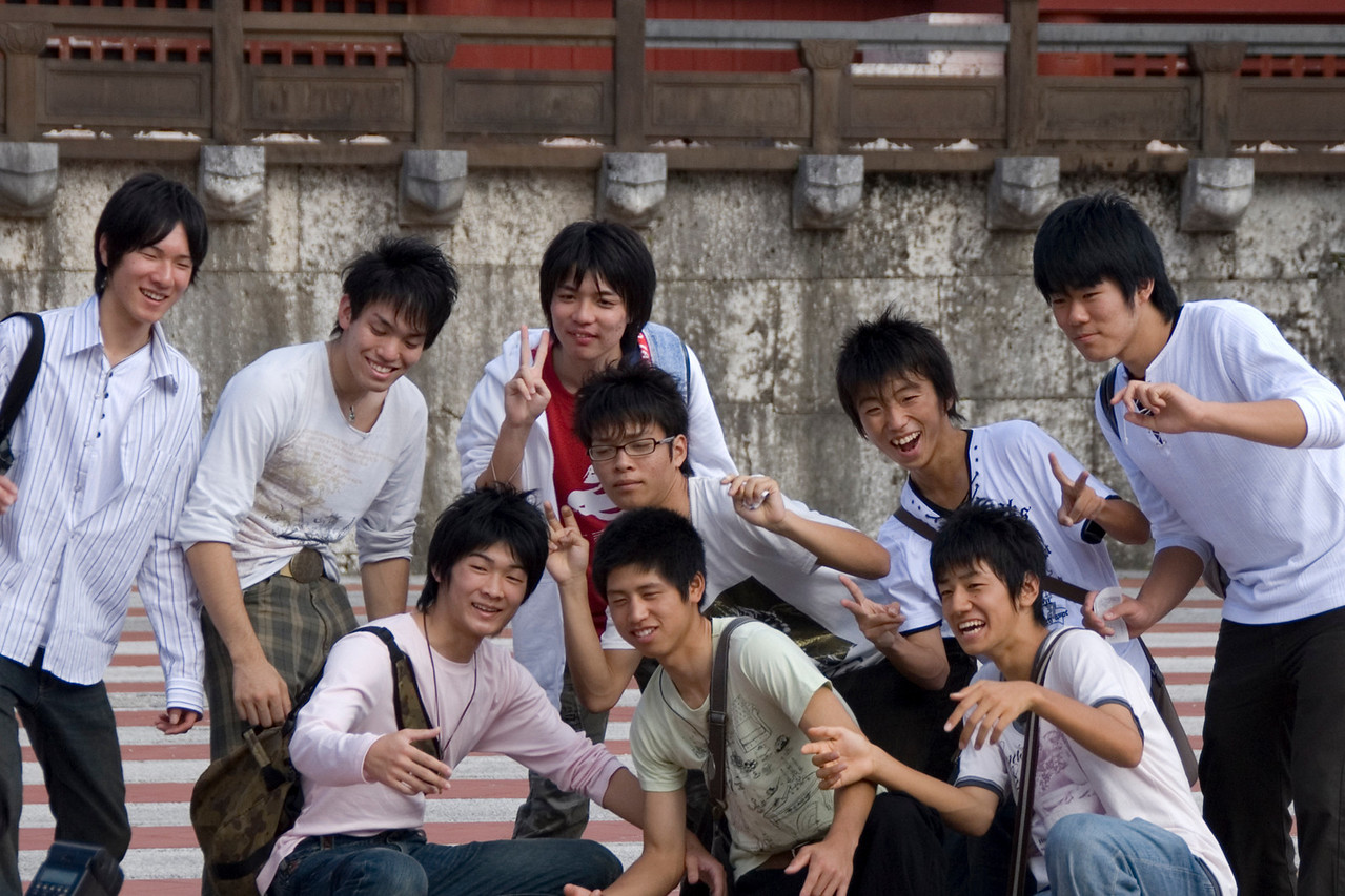 Guys posing outside the Shurijo Castle in Okinawa, Japan