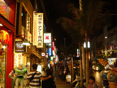 Bright lights in Kokusai Street at night in Okinawa, Japan