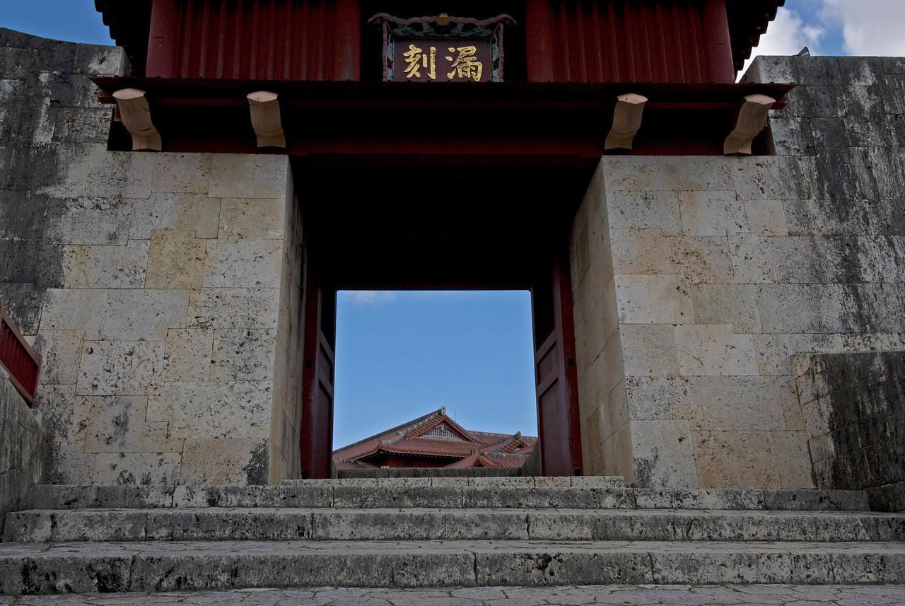 Window peeking out into the Shurijo castle gate in Okinawa, Japan