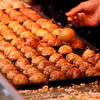 "Making <a target=""NEWWIN"" href=""http://en.wikipedia.org/wiki/Takoyaki"">Takoyaki</a> on the <a target=""NEWWIN"" href=""http://en.wikipedia.org/wiki/D%C5%8Dtonbori"">Dotonbori</a>, Osaka, Japan"