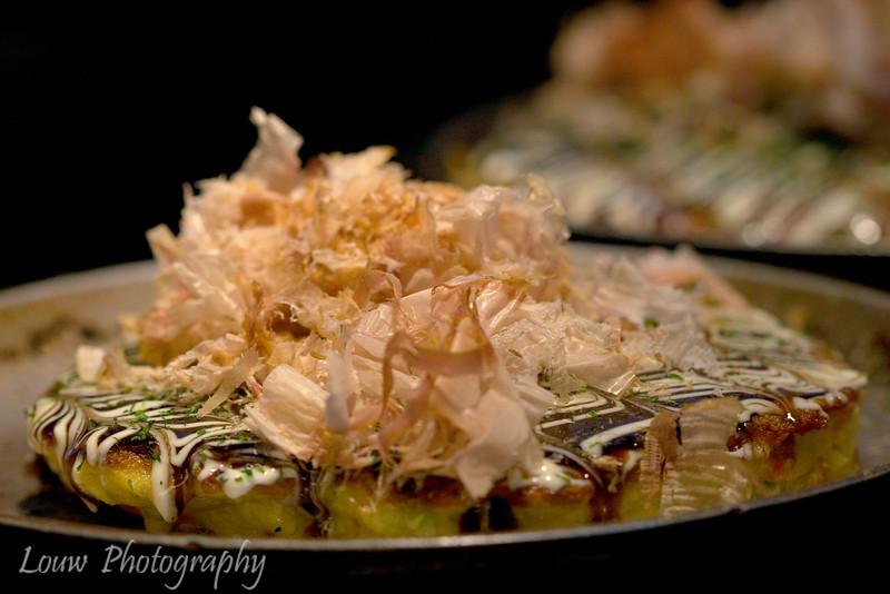 """<a target=""""NEWWIN"""" href=""""http://en.wikipedia.org/wiki/Okonomiyaki"""">Okonomiyaki</a> at Chibo Restaurant, Osaka, Japan"""