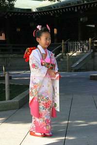 November 15 is Shichi-go-san, a day of prayer for the healthy growth of young children. Shichi-go-san literally means seven, five, three (7-5-3) ; girls aged three and seven, boys aged five, visit a Shinto shrine with their parents. Most girls wear kimonos when making their Shichi-go-san visit, while boys don haori jackets and hakama trousers. The Shichi-go-san customs followed today evolved in the Meiji era (1868-1912). November 15 was chosen for this celebration because it was considered the most auspicious day of the year, according to the traditional Japanese calendar.  If you happen to be in Tokyo on a Nov 15th, go and visit the Meiji Shrine, it really is a lovely occasion to see.  These following photos were taken on 11/15/2005. Shichi-Go-San season, Meiji Shrine, Harajuku Sunday