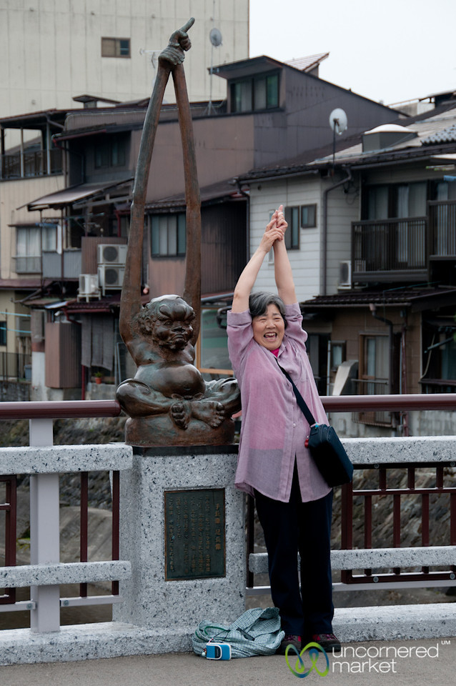 Japanese Woman Imitates Tenagazo Statue - Takayama, Japan