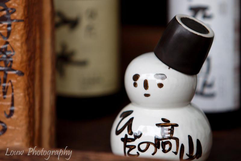 "Sake snowman bottle with cup as a hat, <a target=""NEWWIN"" href=""http://en.wikipedia.org/wiki/Takayama,_Gifu"">Takayama</a>, Japan"
