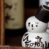 "Sake snowman bottle with cup as a hat, <a target=""NEWWIN"" href=""http://en.wikipedia.org/wiki/Takayama,_Gifu"">Takayama</a>, Japan"