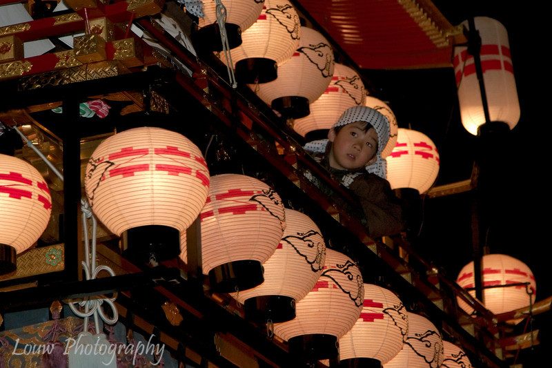 """Young boy rides on a float at the <a target=""""NEWWIN"""" href=""""http://en.wikipedia.org/wiki/Takayama_Festival"""">Takayama Festival</a>, <a target=""""NEWWIN"""" href=""""http://en.wikipedia.org/wiki/Takayama,_Gifu"""">Takayama</a>, Japan"""