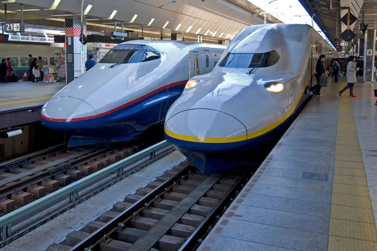 Two bullet trains parked at Shinkansen in Tokyo, Japan