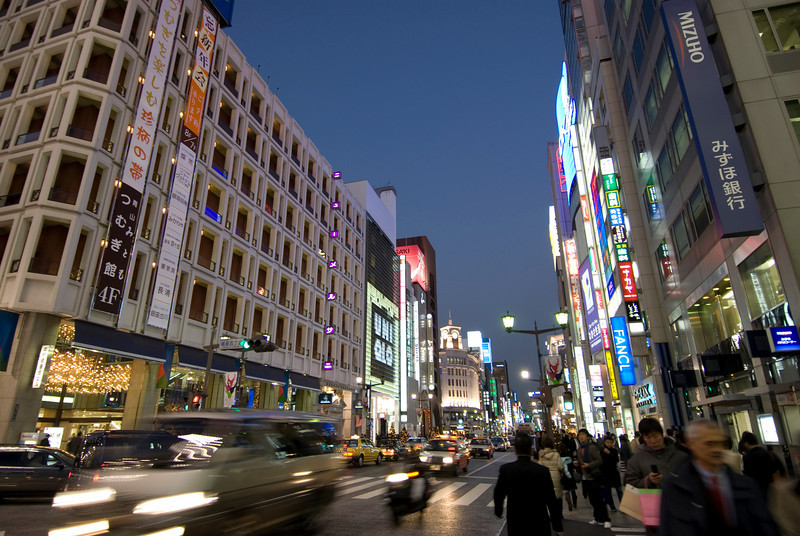 Bustling street scene at night in Ginza, Tokyo, Japan