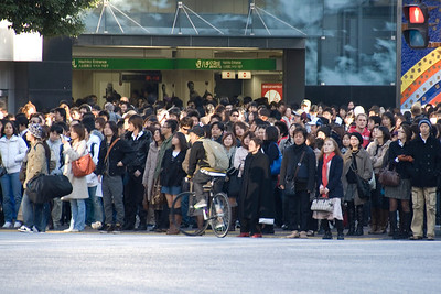 People waiting to cross the Shibuya Intersection in Tokyo, Japan
