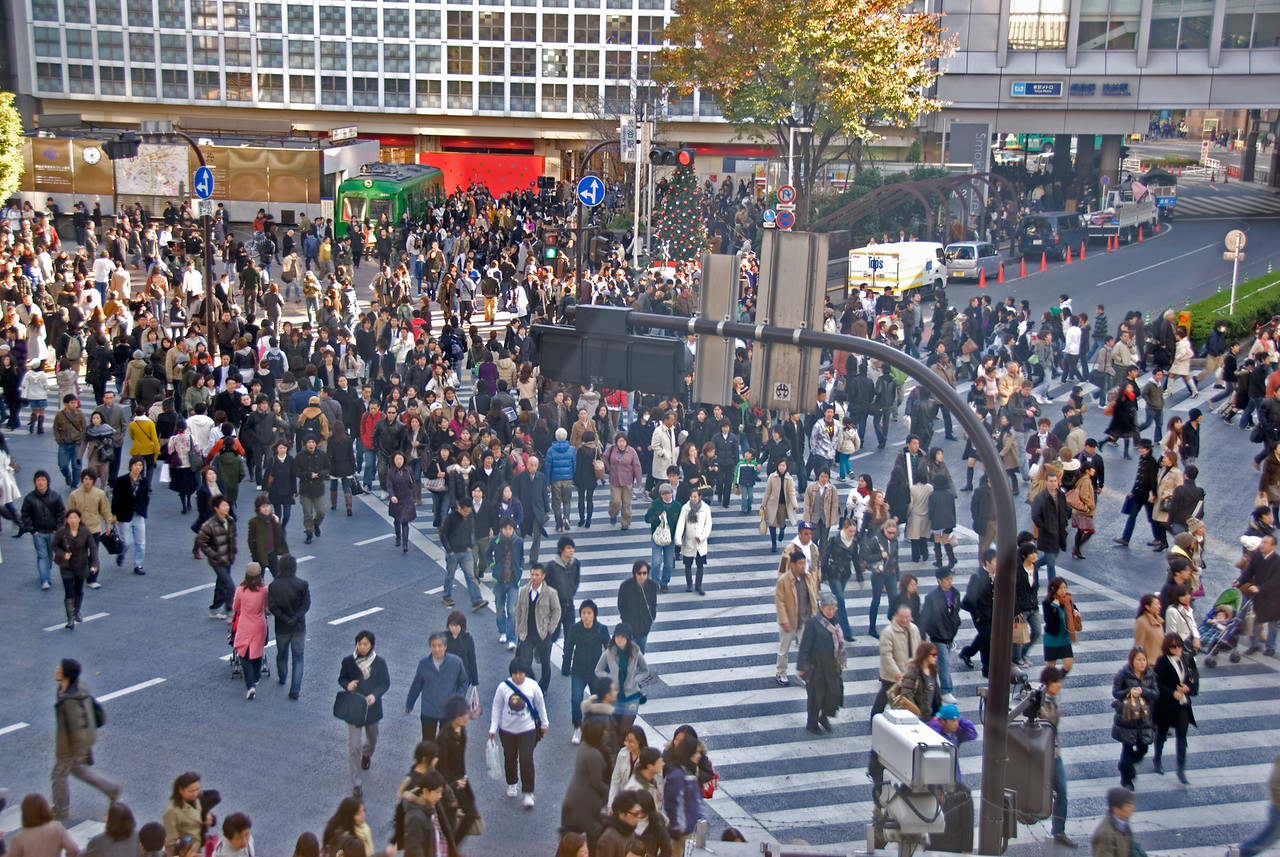People crossing the pedestrian lane at Shibuya Intersection in Tokyo, Japan
