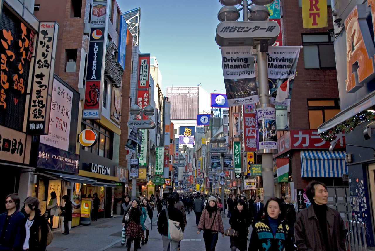 Locals on a leisurely walk at a back street in Shibuya, Tokyo, Japan