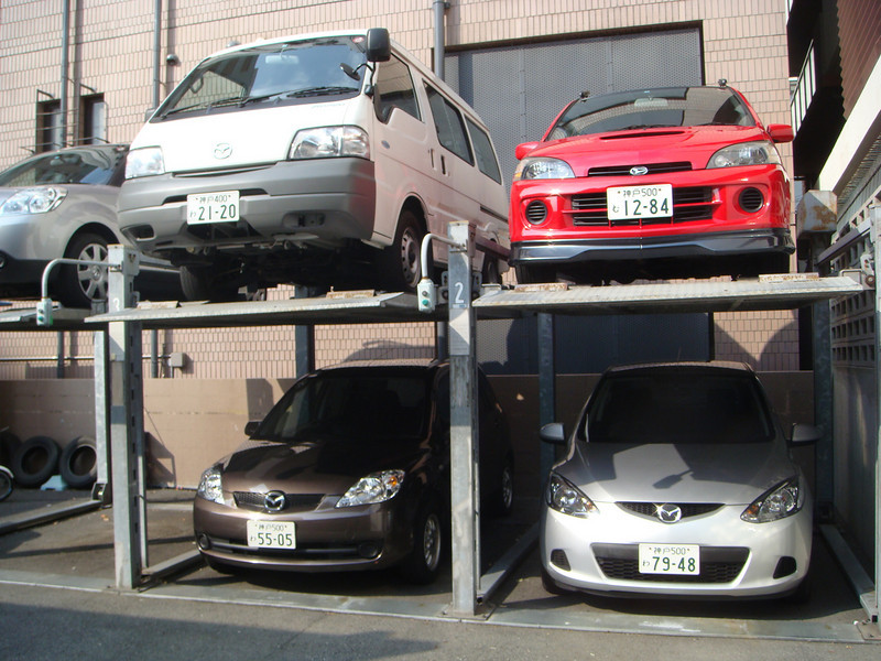 Vehicles parked at a modern parking spot in Tokyo, Japan