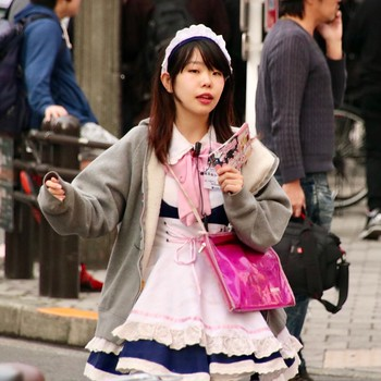 girl advertising maid cafe - Akihabara