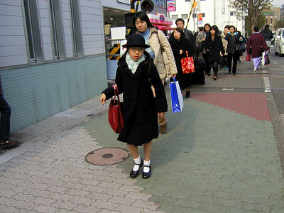 School girl, after the train has passed, Shimomaruko Station on the Tokyu Tamagawa Line, March 2004