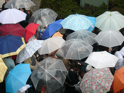 Harajuku shoppers waiting for a store opening on a rainy day. Tokyo Springtime.2007