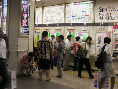 Tokyo, Akihabara Electric Town JR station SUICA card ticketing machines and route boards- nightlife Aug 2002