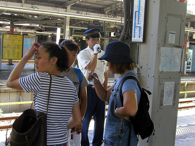 Tokyo, JR rail station platform announcer - Aug 2002