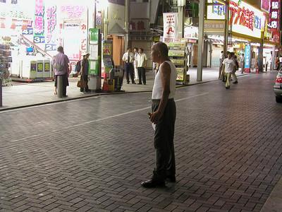 Tokyo, Akihabara Electric Town nightlife Aug 2002 - drunk man with beer