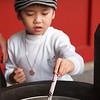 "Young boy lighting incense at <a target=""NEWWIN"" href=""http://en.wikipedia.org/wiki/Sens%C5%8D-ji"">Senso-ji Temple</a>, Toyko, Japan"