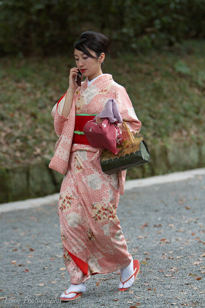 Woman dressed in kimono on her cell phone, Tokyo, Japan