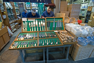 Several kinds of knives on display at vendor stall in Tsukiji Fish Market, Tokyo, Japan