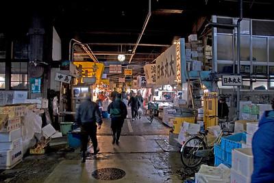 A line of vendor stalls at Tsukiji Fish Market, Tokyo, Japan