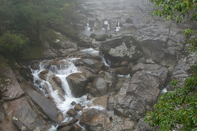 Big rocks piled on top of each other at creek in Yakushima, Japan