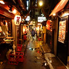 The lantarns identify the venues as izakayas (cheap food and sake) in Omoide Yokocho, informally referred to as Piss Alley, in the Shinjuku neighborhood.