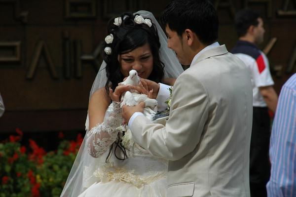 Newlywed Kazakh Couple Holding a Dove - Almaty, Kazakhstan