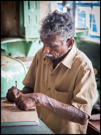 Worker at Pattumallay tea factory
