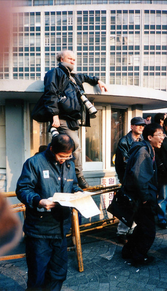 A foreign photographer waiting for the action to begin. 1994, Seoul