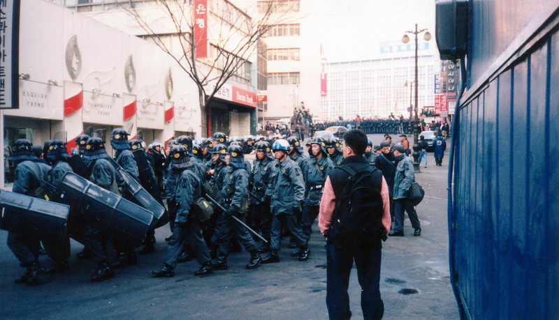 lots of riot Police here and in the background around the Royal Hotel. 1994, Seoul