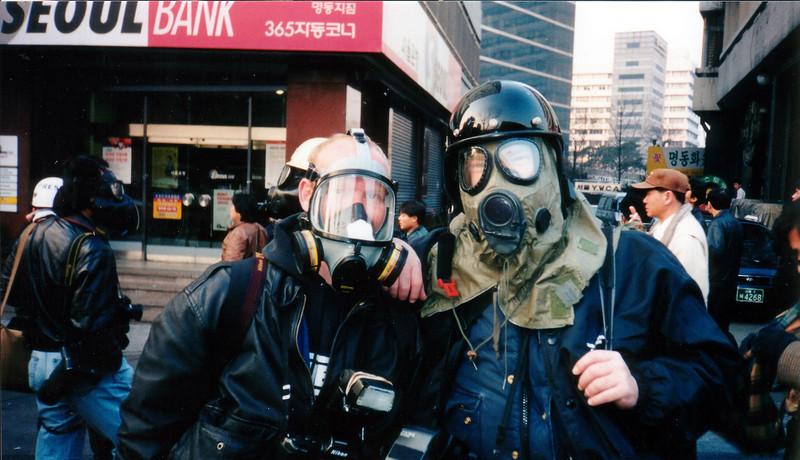 Photographers with their Tear Gas Masks on.. 1994, Seoul