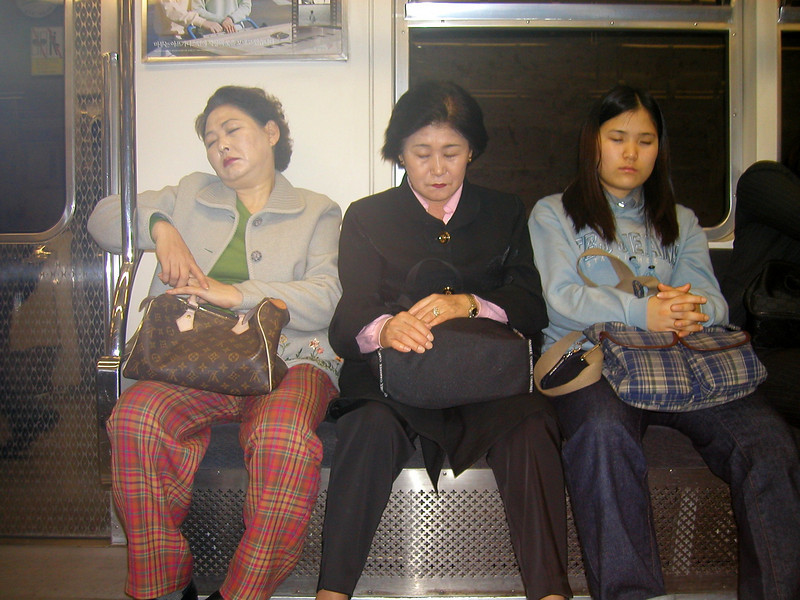 more... sleepy travellers on the subway - Seoul 2002