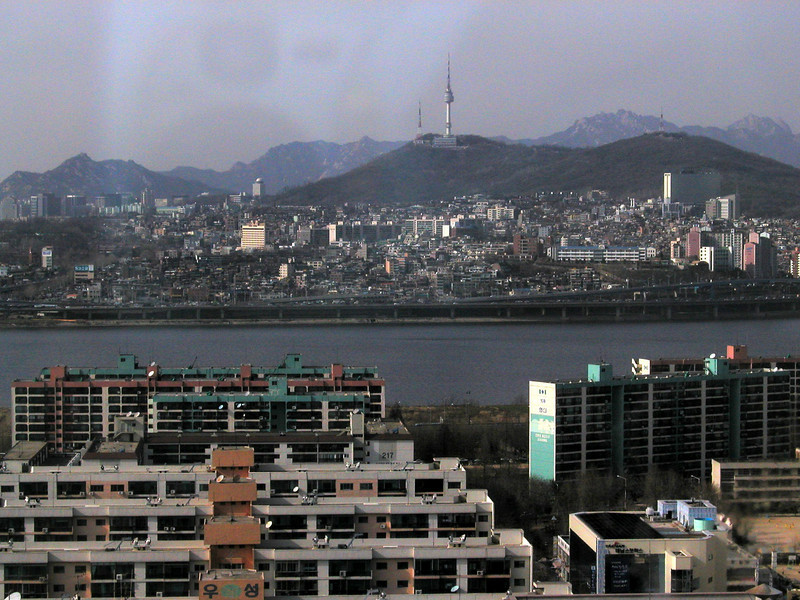 taken in 2002, looking from the Marriott Hotel looking across the Han River to the Seoul Tower. It's a communication and observation tower located in central Seoul, built in 1969, and opened to the public in 1980