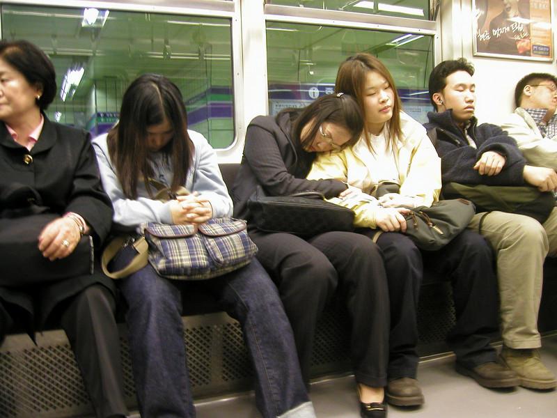 sleepy travellers on the subway - Seoul 2002