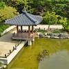 Traditional Korean Garden Paviolion Near Pond With Koi Fish