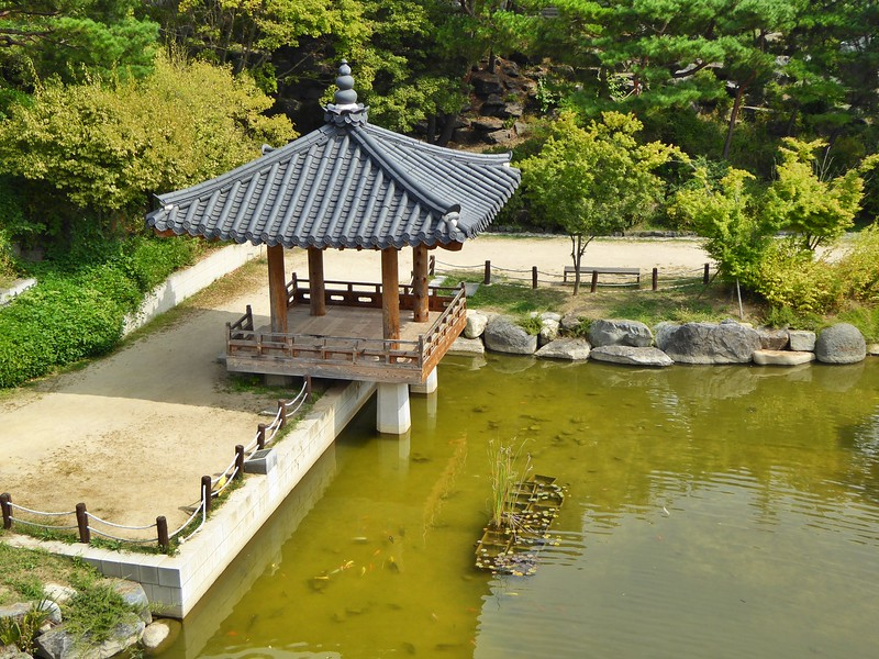 Traditional Korean Garden Paviolion Near Pond With Koi Fish