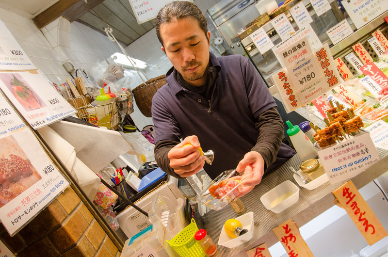 Sampling foods at Nishiki, Kyoto's top food market