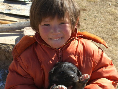 Little Kyrgyz Girl and Puppy - Song Kul Lake, Kyrgyzstan